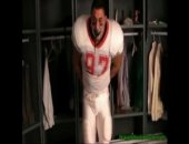 Bound and gagged in the locker room, the muscular jock struggles to free himself.