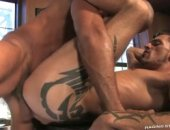 Standing behind the bar, Antonio stretches Tamas hole