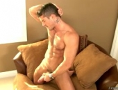 Cody Cummings takes a halftime break to stroke his hot cock