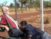 blowing an old man in the park