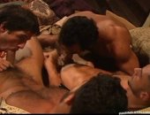 Four men are enjoying the entertainment, dicks out and hard