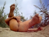 legs in the air wanking on the beach