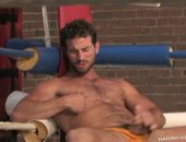 Rusty sits in the ring with his dick poking through his jock